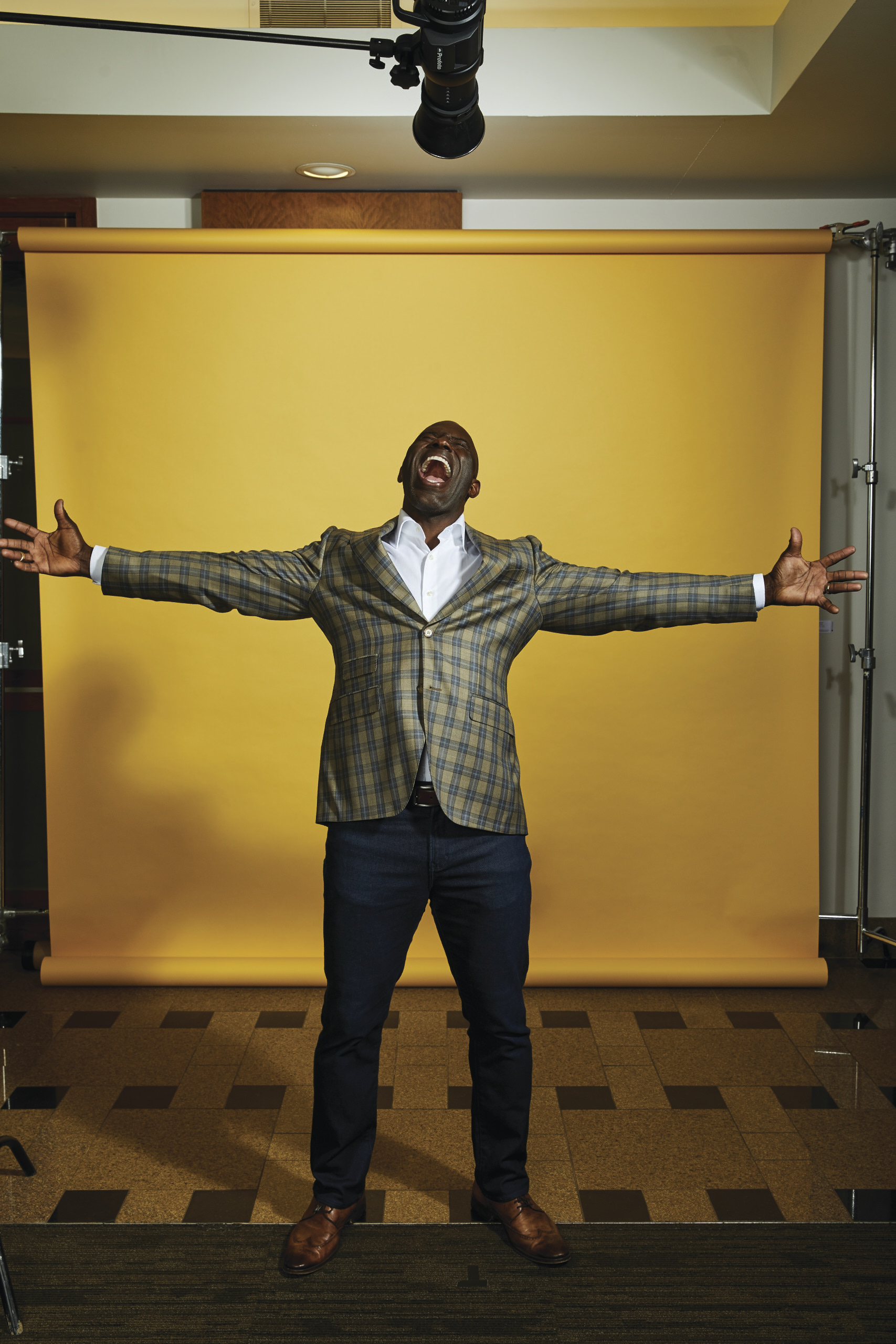 Terrell Davis on yellow background