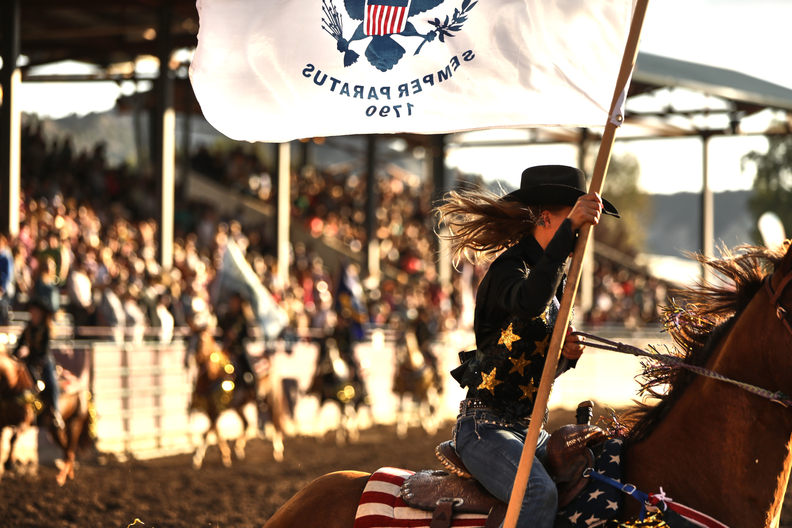 Eagle rodeo in eagle colorado girl riding with flag