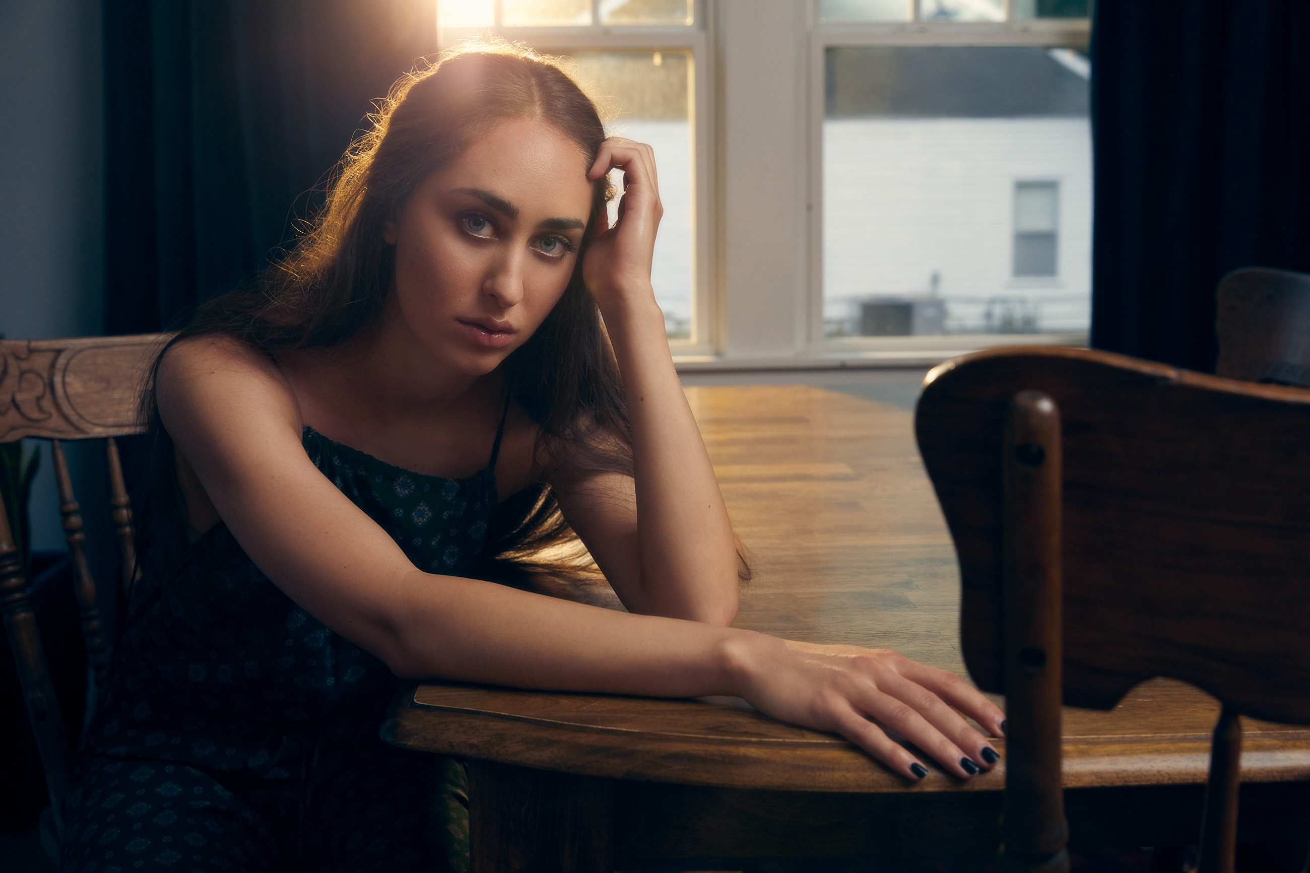 Fleurie leaning on table